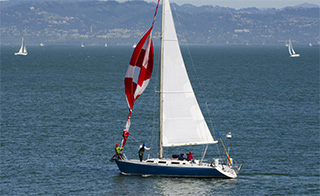 Putting up a sail on a boat while on the San Francisco Bay